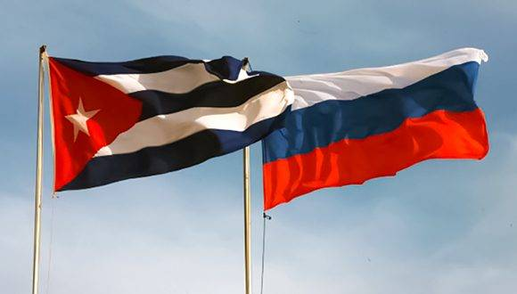 Cuban and Russian flags.