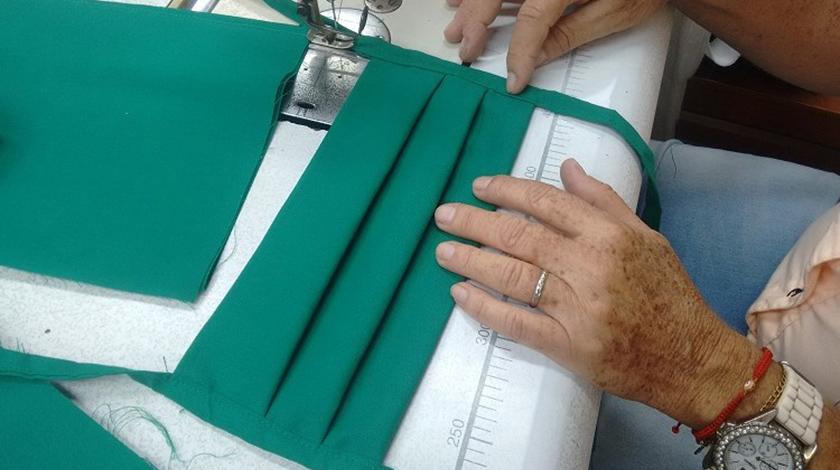 Atelieres y lavanderías camagüeyanas mantienen su contribución al enfrentamiento de la Covid-19
